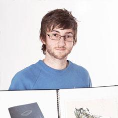 Man holding open notebook