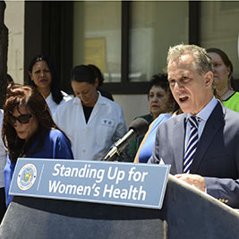 State Attorney General Eric Schneiderman in Jamaica on Tuesday, pointing to a still photo from a video purporting to show physical confrontations between protesters and people attempting to enter the Choices Women's Medical Center.