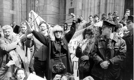Merle Hoffman raises her trademark hanger outside St Patricks Cathedral in New York in 1989
